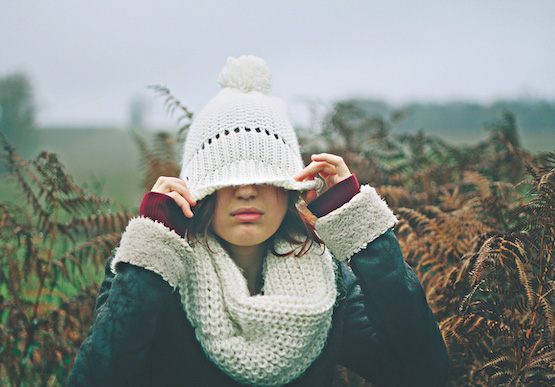 Girl wearing a woolly hat covering her eyes