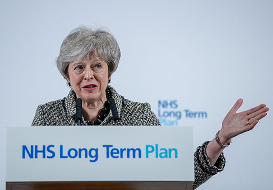 Theresa May speaking at an NHS conference