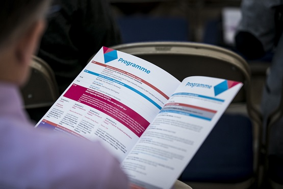 Member reading an MiP Summit programme